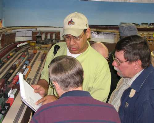 Richard Clayton clarifying a switch list to other APN members during a 2007 operating session
