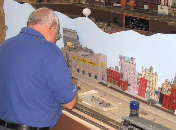 Rich Cutler working on the town of West Roxburgh on the layout of APN