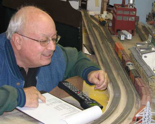Rich Cutler checks box car road numbers against his switching list during a 2007 operating session at APN