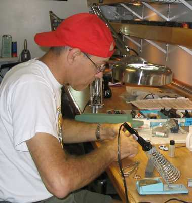 Ray McClure installing a decoder at the workbench at APN